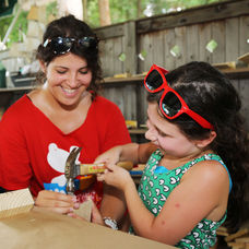 Counselor-helping-camper-woodwork