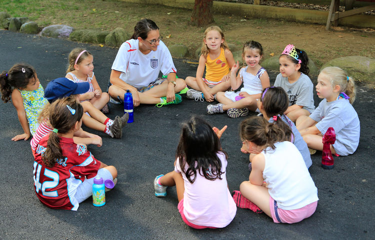 A group of campers discusses what it means to be an Elmwood camper.