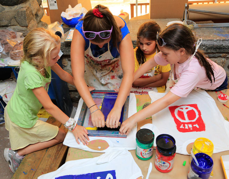 Campers create their own shirt design in Creative Arts.